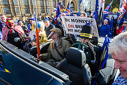 London, UK. 14th February, 2019. Boris Johnson lookalike Drew Galdron, also known as Faux BoJo, and men disguised as Jacob Rees-Mogg and Nigel Farage join anti-Brexit activists protesting outside the Houses of Parliament in Westminster.