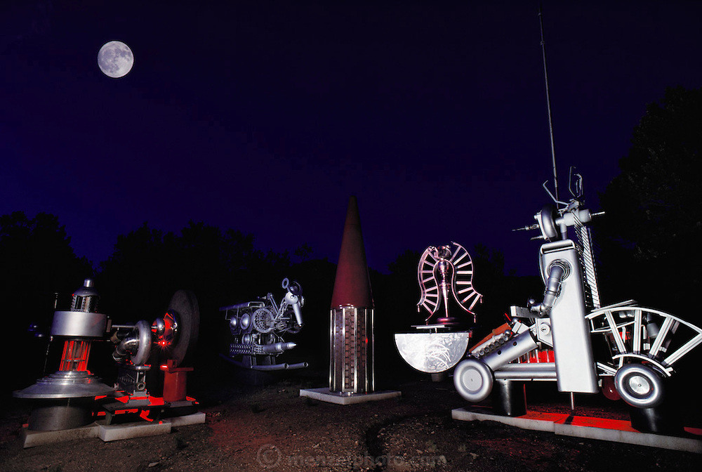 """An """"atomic sculpture"""" made from Los Alamos National Laboratory scraps, by Tony Price (1937-2000), of Santa Fe, New Mexico. Tony Price, bought scrap from the nearby Los Alamos National Lab weekly public auctions, and built sculptures which convey anti-nuclear themes and messages. (1988). Seen here """"The Last S.A.L.T. Talks"""" sculpture group. (1988)"""