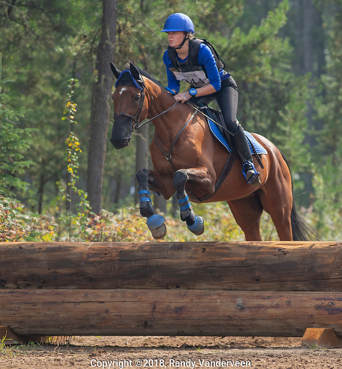Photo Randy Vanderveen<br /> County of Grande Prairie, Alberta<br /> 2018-09-02<br /> Nessa Ingram aboard Henry Rex clears an obstacle during the cross-country event at the South Peace Horse Club's eventing at Evergreen Park, Sunday. The two-day annual equestrian competition had riders and mounts competing in dressage, stadium (show jumping) and cross country.