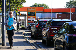 © Licensed to London News Pictures. 29/09/2021. London, UK. Motorists queue for the sixth day of the fuel crisis at Sainsbury's petrol station in north London, amid fears of fuel running out due to a shortage of HGV drivers. According to the government, 75 army tanker drivers have been put on standby to deliver motor fuel in order to ease the chaos at petrol stations. Photo credit: Dinendra Haria/LNP