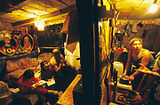 Roma Gypsies living in a squat in a river delta. Their village is regularly flooded and many houses have been washed away. Hermonovice, Slovakia 2003. ..Roma Gypsies left Rajasthan in India a thousand years ago, in the ninth and tenth centuries. They were pushed west by the Ottoman Muslim Empire as it moved through Persia towards the frontiers of Europe. They entered Europe in the foutrteenth century and were slaves in Romania and Moldavia until the mid 1850s. There are about 15 million Roma gypries in the world, about 12 million who live in Europe. they are Europe's largest ethnic minority. They have rich traditions and culture, their own language. They are renowned for their prowess in music and dance; they are also skilled craftsman, metal roofmakers, silver and goldsmiths. Their traveling and nomadic lifestyle which grew from a necessity to find work, and because they were often moved on from one place to the next, has given them both a liberty but also marks them as different and they are often feared by sedentary peoples, who label and scapegoat them. They are hardy survivors and live in the brunt of racism and prejudice, often marginalised, living in poverty, without proper human rights afforded to them..