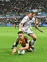 Football - 2019 / 2020 EFL Carabao (League) Cup - Second Round: Swansea City vs. Cambridge United<br /> <br /> Leon Davies of Cambridge United  brought down by  Ben Wilmot of Swansea City, at Liberty Stadium.<br /> <br /> COLORSPORT/WINSTON BYNORTH