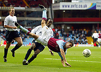 Photograph: Scott Heavey.<br />Aston Villa v Blackburn Rovers. FA Baclaycard Premiership. 05/10/2003.<br />Mark Delaney is thrown in the air by a challenge from Ricardo Gardner