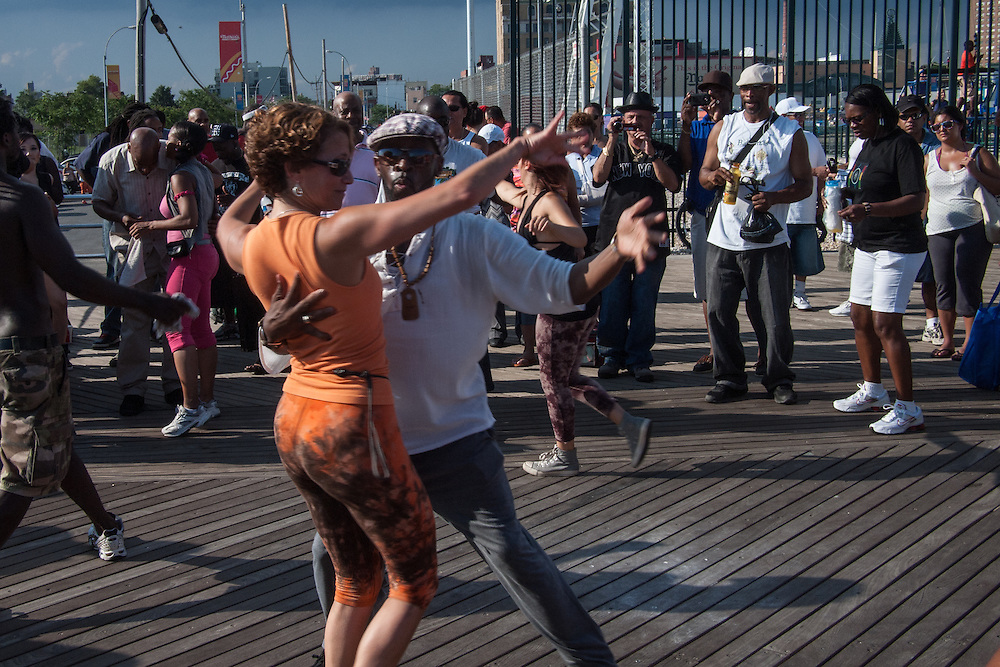 Dancers on the boardwalk at Coney Island.