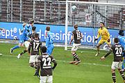 Fussball: 2. Bundesliga, FC St. Pauli - Holstein Kiel, Hamburg, 09.01.2021<br /> Joshua Mees (Kiel) erziel das 1:1 gegen Torwart Dejan Stojanovic (Pauli)<br /> © Torsten Helmke