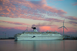 © Licensed to London News Pictures. 12/09/2016. Hues of pink and blue spread across the sky as the cruise ship Magellan arrives at Tilbury, as seen from Gravesend.  Gravesend recorded the hottest temperature of anywhere in the country in August. The south east is expected to have days of warm, sunny weather. Credit : Rob Powell/LNP