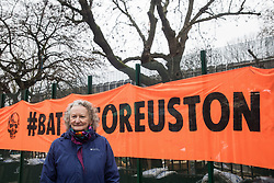 London, UK. 31 January, 2021. Jenny Jones, Baroness Jones of Moulsecoomb, prepares for an interview on BBC News as climbers from the National Eviction Team (NET) dismantle a camp in Euston Square Gardens built by anti-HS2 activists from umbrella campaign group HS2 Rebellion seeking to protect trees there from felling by HS2 Ltd in connection with the controversial HS2 high-speed rail project. Five activists continue to occupy tunnels beneath the camp, including Dan Hooper who was known as the roads protester Swampy during the 1990s.