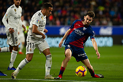 December 9, 2018 - Huesca, Aragon, Spain - Moi Gomez of SD Huesca (6) competes for the ball with Lucas Vazquez of Real Madrid (17) during the LaLiga match between SD Huesca and Real Madrid at El Alcoraz. (Credit Image: © Daniel Marzo/Pacific Press via ZUMA Wire)