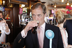 © Licensed to London News Pictures. 18/05/2019. Canvey Island, UK. Brexit Party leader Nigel Farage drinks a beer as he campaigns for the European Elections in Canvey Island in Essex. The European Elections are being held on Thursday 23rd May. Photo credit: Peter Macdiarmid/LNP