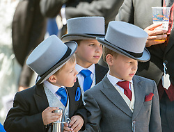 © Licensed to London News Pictures. 07/06/2014. Epsom, UK. Young racegoers wait for the arrival of the Queen.  Derby Day today 7th June 2014 at Epsom 2014 Investic Derby Festival in Surrey. Traditionally, elegant, fashionable racegoers gather for a classic day's racing at Epsom Racecourse, Surrey. Photo credit : Stephen Simpson/LNP