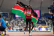 Timothy Cheruiyot (Kenya), 1500 Metres Men - Final, Winner, Gold Medal, with flag, during the 2019 IAAF World Athletics Championships at Khalifa International Stadium, Doha, Qatar on 6 October 2019.