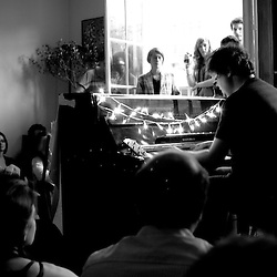 "Ron Sexmith (Canada) performing at the ""Soiree de poche #3"" (pocket night #3): a concert happening in an appartment. Organised by La Blogotheque.. .June 2008, 30th / photo: Antoine Doyen"
