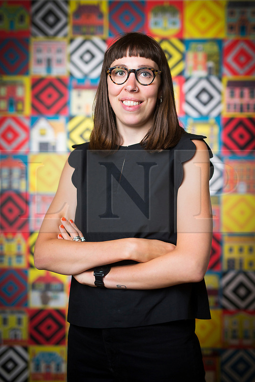 """© Licensed to London News Pictures. 15/06/2017. Wakefield UK. Picture shows Illustrator Alice Pattullo in front of her wall hanging screen printed """"quilt"""", the artist has a new exhibition at the Yorkshire Sculpture park called Of House & Home which is her most ambitious project to date & includes 60 new screen printed editions revealing Pattullo's fascination with traditions, superstitions & folklore. The exhibition takes visitors on a journey through a victorian household from garden to parlour culminating with the heart of the home a recreation of a traditional fireplace & mantlepiece. Photo credit: Andrew McCaren/LNP"""