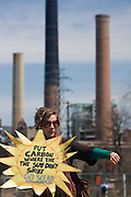 "Boulder, CO (4/27/2010) -- Four climate activists (Kate Clark, Eric Ross, Erik Bonnett and Tom Weis) climbed to the top of the large coal mound in front of the Valmont Power Plant as a rally cheered outside, deploying a banner reading ""RENEWABLES NOW"" and erecting two mock wind turbines. The activists claimed the coal pile for about 1.5 hours before they were finally taken into custody."