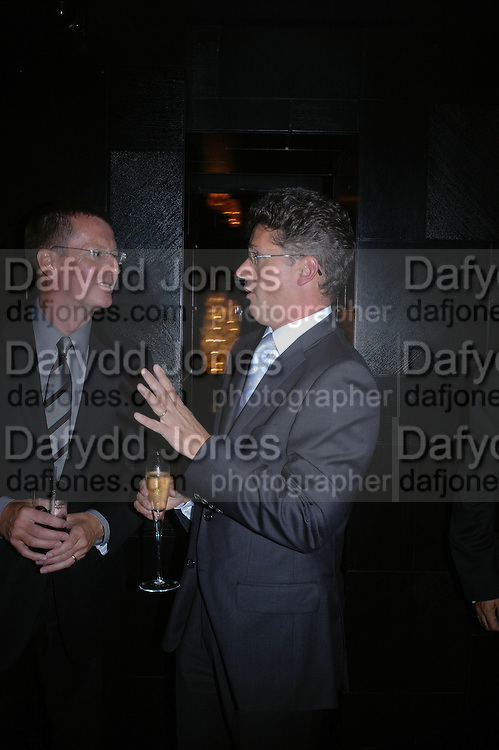 Andrew Skinner and Ian Dyson. Marks and Spencer celebrate the launch of the new men's Autograph collection. Fifty Below. 50 St. James's St. London. SW1. 7 September 2005. ONE TIME USE ONLY - DO NOT ARCHIVE  © Copyright Photograph by Dafydd Jones 66 Stockwell Park Rd. London SW9 0DA Tel 020 7733 0108 www.dafjones.com