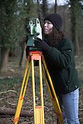 Woman surveyor in winter England