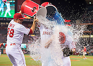 The Angels' Joe Smith and Mike Trout douse closer Huston Street after his 300th career save during the Halos' 5-2 victory over the Minnesota Twins Wednesday night at Angel Stadium.