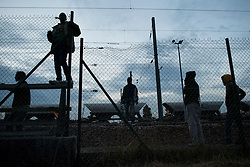 **Images taken on the evening of the 11th of August** © London News Pictures. 11/08/2015. Calais, France. A group of migrants who have accessed the Eurotunnel tracks look out for police from the site perimeter fence.  Photo credit: Ben Cawthra/LNP