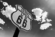 ROUTE 66-ARIZONA- As scattered clouds roll past , a vintage, Route 66 road sign marks an original section of the Mother Road through the mountains near Cool Springs, AZ. Photo by Colin E Braley