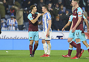 Mark Noble of West Ham United and Huddersfield Town's Jonathan Hogg chat at full time  during the Premier League match between Huddersfield Town and West Ham United at the John Smiths Stadium, Huddersfield, England on 13 January 2018. Photo by Paul Thompson.