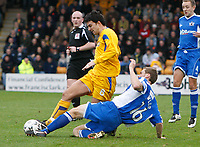 Photo: Steve Bond/Sportsbeat Images.<br />Torquay United v Exeter City. The FA Blue Square Premier. 01/01/2008. Tim sills (L) is tackled by Matt Taylor (lower R)