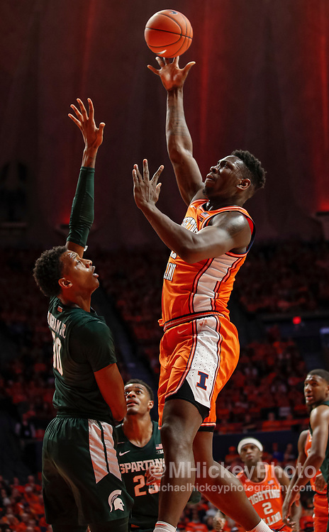 CHAMPAIGN, IL - FEBRUARY 11: Kofi Cockburn #21 of the Illinois Fighting Illini shoots the ball against Marcus Bingham Jr. #30 of the Michigan State Spartans during the first half at State Farm Center on February 11, 2020 in Champaign, Illinois. (Photo by Michael Hickey/Getty Images) *** Local Caption *** Kofi Cockburn