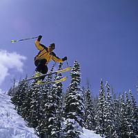 SKIING, Big Sky, Montana. Patrick Shanahan catches air on Stump Farm run.