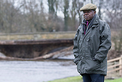 © Licensed to London News Pictures. 30/12/2015. Tadcaster UK. Dr John Sentamu the Archbishop of York has visited Tadcaster bridge this morning to see the full extent of the damage done by flood water to the Bridge in Tadcaster town centre after it collapsed last night.  Photo credit: Andrew McCaren/LNP