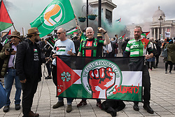 London, UK. 22nd May, 2021. Celtic FC fans, well-known for their support of the Palestinian cause, join tens of thousands of people taking part in the National Demonstration for Palestine. It was organised by pro-Palestinian solidarity groups in protest against Israel's recent attacks on Gaza, its incursions at the Al-Aqsa mosque and its attempts to forcibly displace Palestinian families from the Sheikh Jarrah neighbourhood of East Jerusalem.