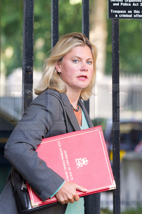"""© Licensed to London News Pictures. 29/08/2013. London, UK. International Development Secretary Justine Greening arrives for a meeting of the British cabinet on Downing Street in London today (29/08/2013) as a recalled British Parliament prepares to debate the possibility of """"direct"""" military action over recent reports an alleged chemical weapons attack in Syria. Photo credit: Matt Cetti-Roberts/LNP"""