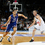 Anadolu Efes's Furkan Korkmaz (L) and Real Madrid's Jaycee Carrol (R) during their Turkish Airlines Euroleague Basketball Group A Round 5 match Anadolu Efes between Real Madrid at Abdi ipekci arena in Istanbul, Turkey, Thursday, November 14, 2014. Photo by Aykut AKICI/TURKPIX