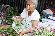Flowers for sale at an early morning street market in Mandalay on 25th May 2016, Myanmar