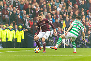 Michael Smith of Hearts slides the ball past Celtic's Michael Johnston during the William Hill Scottish Cup Final match between Heart of Midlothian and Celtic at Hampden Park, Glasgow, United Kingdom on 25 May 2019.