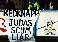 Photo: Javier Garcia/Back Page Images<br />Portsmouth v Arsenal, FA Barclays Premiership, Fratton Park, 19/12/04<br />Portsmouth fans have a message for former manager Harry Redknapp