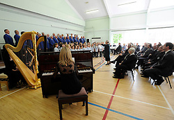 The Ynysowen Male Voice Choir and Ysgol Rhyd y Grug school choirs singiing during a reception for families and survivors at Aberfan and Merthyr Vale community centre in Aberfan, Wales, on the 50th anniversary of the tragedy.