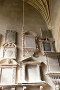 Wall mounted historic grave memorials Interior of church of Saint Bartholomew, Corsham, Wiltshire, England, UK