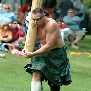 August 18, 2007 -- BRUNSWICK, Maine. Mike Zolkewicz of Springfield, Mass throws the caber at the Maine Highland Games at Thomas Point Beach on Saturday. The caber is an 18-foot long tree trunk which weighs close to 165 lbs. The point of the ancient competition is to flip the caber's lower end up and over and land it on the ground, aimed straight away from the thrower. Photo by Roger S. Duncan.