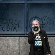 Sean Clerkin of the Scottish Resistance speaking at a demo in Cadogan Street, Glasgow. Picture Robert Perry 29th Jan 2016<br /> <br /> Must credit photo to Robert Perry<br /> FEE PAYABLE FOR REPRO USE<br /> FEE PAYABLE FOR ALL INTERNET USE<br /> www.robertperry.co.uk<br /> NB -This image is not to be distributed without the prior consent of the copyright holder.<br /> in using this image you agree to abide by terms and conditions as stated in this caption.<br /> All monies payable to Robert Perry<br /> <br /> (PLEASE DO NOT REMOVE THIS CAPTION)<br /> This image is intended for Editorial use (e.g. news). Any commercial or promotional use requires additional clearance. <br /> Copyright 2014 All rights protected.<br /> first use only<br /> contact details<br /> Robert Perry     <br /> 07702 631 477<br /> robertperryphotos@gmail.com<br /> no internet usage without prior consent.         <br /> Robert Perry reserves the right to pursue unauthorised use of this image . If you violate my intellectual property you may be liable for  damages, loss of income, and profits you derive from the use of this image.