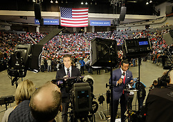 October 9, 2018 - Council Bluffs, IOWA - National network correspondents NBC's PETER ALEXANDER, left, and Fox's KEVIN CORKE, right, do stand ups for their nightly news reports while waiting President Donald Trump (R) to addresse attendees at a campaign Make America Great Again rally at the Mid-America Center in Council Bluffs, Iowa Thursday, October 9, 2018. (Credit Image: © Jerry Mennenga/ZUMA Wire)