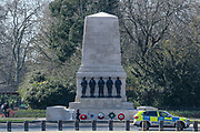Police are seen in a stationary patrol nearby the Guards Memorial from Cavalry Museum looking towards St James Park in London, Wednesday, March 25, 2020. British lawmakers voted to shut down Parliament for 4 weeks, due to the coronavirus outbreak. (Photo/Vudi Xhymshiti)