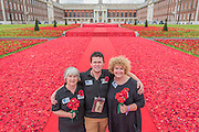 5000 Poppies, startes as a tribute by Lynn Berry and Margaret Knight to their fathers who fought in WW2 and, with the help of creative Director Phillip Johnson (all pictured), became a project where over 50000 contributors submitted more than a quarter of a million hand knitted poppies.