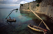 Two dhows near Saint Sebastian Fortress walls. The Fort was build by the Portuguese in XVI Century