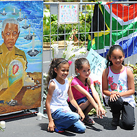 CAPE TOWN, SOUTH AFRICA - Saturday 7 December 2013, young children in front of some of the condolence messages during a time of national mourning the death of the first democratically elected president, Nelson Mandela, in front of the Cape Town City Hall.<br /> Photo by Roger Sedres/ImageSA