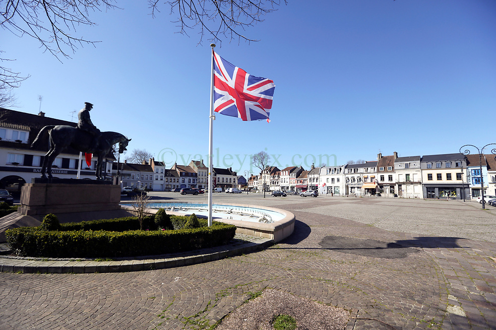 23 March 2020. Montreuil Sur Mer, Pas de Calais, France. <br /> Coronavirus - COVID-19 in Northern France.<br /> <br /> A statue of Field-Marshal Sir Douglas Haig looks down on the eerily deserted main square of the ancient citadel town of Montreuil Sur Mer, the former headquarters of the British Army during WW1. The usually bustling market square is now deserted since From March 16th French lawmakers imposed strict controls on the movement of people in an effort to stem the spread of the virus. Anyone leaving their home must carry with them an 'attestation,' in a effect a self administered permit to allow them out of the house. If stopped by the police, one must produce a valid permit along with identification papers. Failure to do so is punishable with heavy fines. Movement in France has been heavily restricted by the government.<br /> <br /> Montreuil Sur Mer was the headquarters of the British Army under Field-Marshal Sir Douglas Haig from March 1916 to April 1919. Over 1,200 year old, the ancient fortified  town with its high ramparts has endured through history, surviving the plague and King Henry VIII's invasion of France in 1544 when the Duke of Norfolk under Henry VIII's command laid a disastrous siege to the town which held firm until Norfolk was forced to withdraw in 1545. Residents are confident the ancient town can survive the coronavirus too. <br /> Photo©; Charlie Varley/varleypix.com