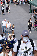 With many people and families staying in the UK for their Summer break during the school holidays, a large number of domestic tourists, who may normally have been travelling abroad, have decended on the capital to see the sights, as seen here on the South Bank on 11th August 2021 in London, United Kingdom. Following the Coronavirus / Covid-19 health scare of the last two years, and with some travel restrictions still in place, more people have chosen a staycation which is a holiday spent in ones home country rather than abroad, or one spent at home and involving day trips to local attractions.