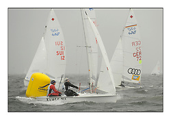 470 Class European Championships Largs - Day 2.Wet and Windy Racing in grey conditions on the Clyde...RUS97, Alisa KIRILYUK, Lyudmila DMITRIEVA, Moscow Sailing SChool...
