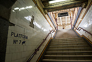 Stairs leading up to a train platform at Flinders Street Station, Melbourne, Australia