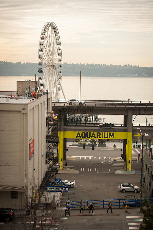 2017 DECEMBER 12 - View of the waterfront and the Alaskan Way Viaduct and Seattle Great Wheel and Elliott Bay. In the background is West Seattle. By Richard Walker