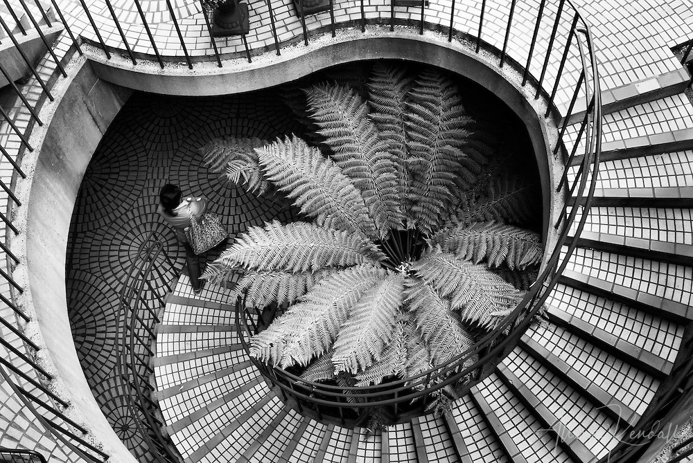 Architectural urban detail, a woman walks down a spiral staircase in downtown San Francisco<br /> <br /> Prints: https://bit.ly/descent-BW-architectural-abstract