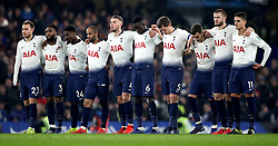 Tottenham Hotspur players stand watching the penalty shootout during the Carabao Cup Semi Final, second leg match at Stamford Bridge, London.